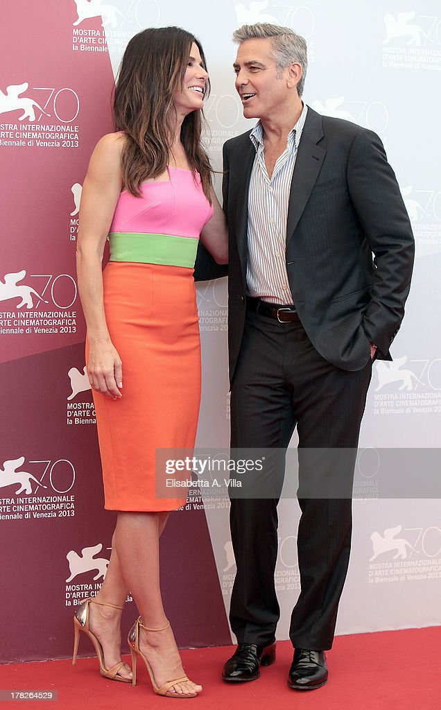 Actress Sandra Bullock and actor George Clooney attend 'Gravity' Photocall during the 70th Venice International Film Festival at the Casino on August 28, 2013 in Venice, Italy.