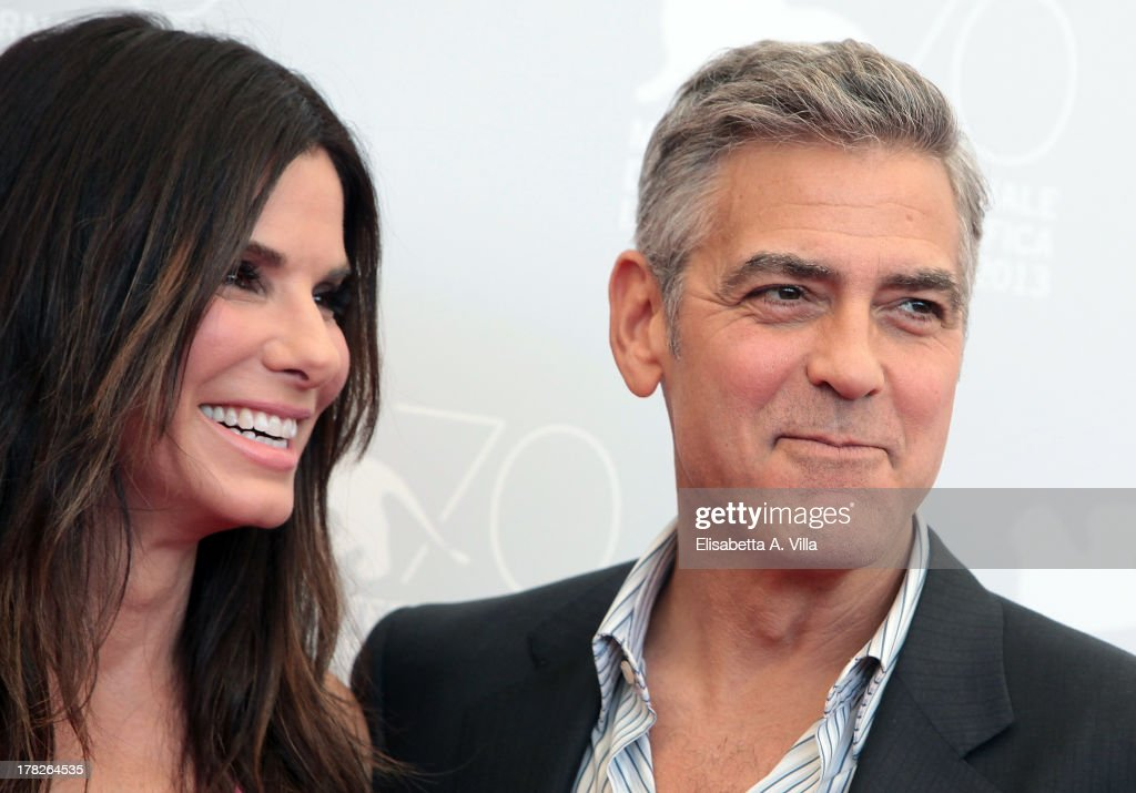 Actress <a gi-track='captionPersonalityLinkClicked' href=/galleries/search?phrase=Sandra+Bullock&family=editorial&specificpeople=202248 ng-click='$event.stopPropagation()'>Sandra Bullock</a> and actor <a gi-track='captionPersonalityLinkClicked' href=/galleries/search?phrase=George+Clooney&family=editorial&specificpeople=202529 ng-click='$event.stopPropagation()'>George Clooney</a> attend 'Gravity' Photocall during the 70th Venice International Film Festival at the Casino on August 28, 2013 in Venice, Italy.
