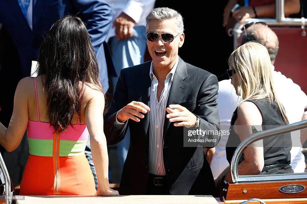 Actress Sandra Bullock and actor George Clooney attend the 'Gravity' photocall during the 70th Venice International Film Festival at the Palazzo del Casino on August 28, 2013 in Venice, Italy.
