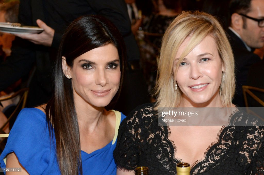 Actress Sandra Bullock (L) and actress/comedienne Chelsea Handler attend the 2014 AFI Life Achievement Award: A Tribute to Jane Fonda at the Dolby Theatre on June 5, 2014 in Hollywood, California. Tribute show airing Saturday, June 14, 2014 at 9pm ET/PT on TNT.