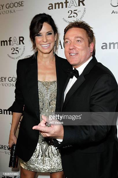 Actress Sandra Bullock and agent Kevin Huvane arrive at The 2011 amfAR Inspiration Gala Los Angeles held at the Chateau Marmont on October 27 2011 in...