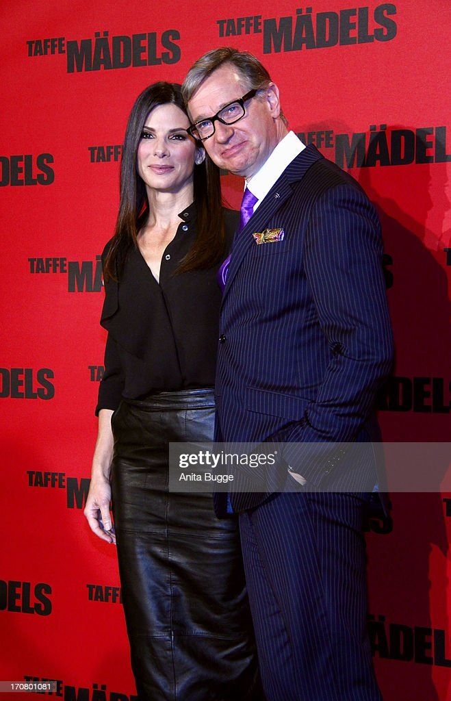 Actress Sandra Bullock and director Paul Feig attend a 'Taffe Maedels' photocall at Hotel De Rome on June 18, 2013 in Berlin, Germany.