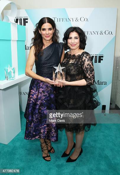 Actress Sandra Bullock and honoree Sue Kroll recipient of The Tiffany Co / Bruce Paltrow Mentorship Award pose backstage at the Women In Film 2015...