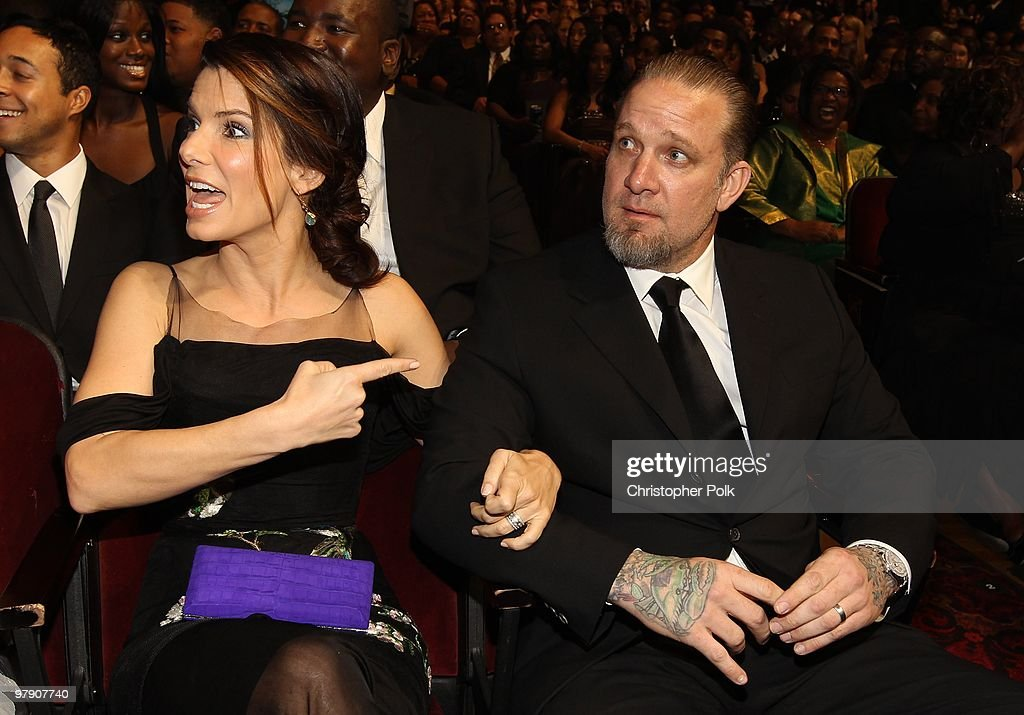Actress <a gi-track='captionPersonalityLinkClicked' href=/galleries/search?phrase=Sandra+Bullock&family=editorial&specificpeople=202248 ng-click='$event.stopPropagation()'>Sandra Bullock</a> and husband Jesse James in the audience during the 41st NAACP Image awards held at The Shrine Auditorium on February 26, 2010 in Los Angeles, California.