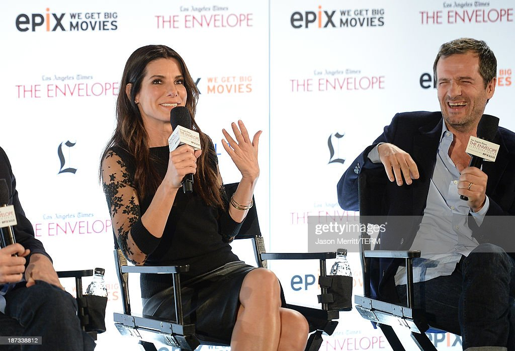 Actress <a gi-track='captionPersonalityLinkClicked' href=/galleries/search?phrase=Sandra+Bullock&family=editorial&specificpeople=202248 ng-click='$event.stopPropagation()'>Sandra Bullock</a> and producer David Hayman attend the L.A. Times Envelope Screening Series and Q&A of 'Gravity' at ArcLight Sherman Oaks on November 7, 2013 in Sherman Oaks, California.
