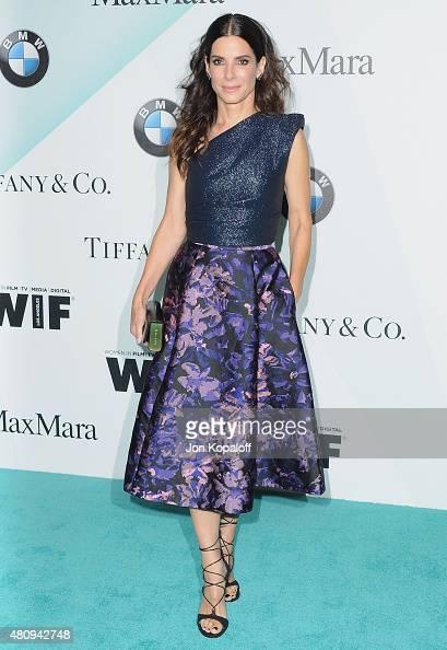 Actress Sandra Bullock arrives at Women In Film 2015 Crystal Lucy Awards at the Hyatt Regency Century Plaza on June 16 2015 in Los Angeles California