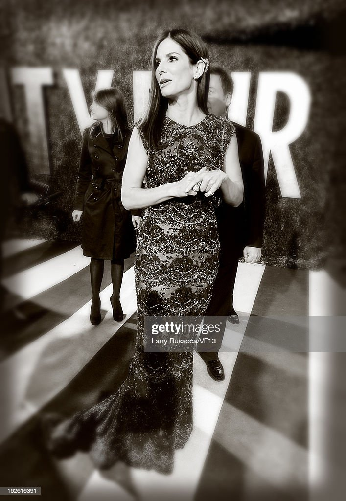 Actress <a gi-track='captionPersonalityLinkClicked' href=/galleries/search?phrase=Sandra+Bullock&family=editorial&specificpeople=202248 ng-click='$event.stopPropagation()'>Sandra Bullock</a> arrives for the 2013 Vanity Fair Oscar Party hosted by Graydon Carter at Sunset Tower on February 24, 2013 in West Hollywood, California.