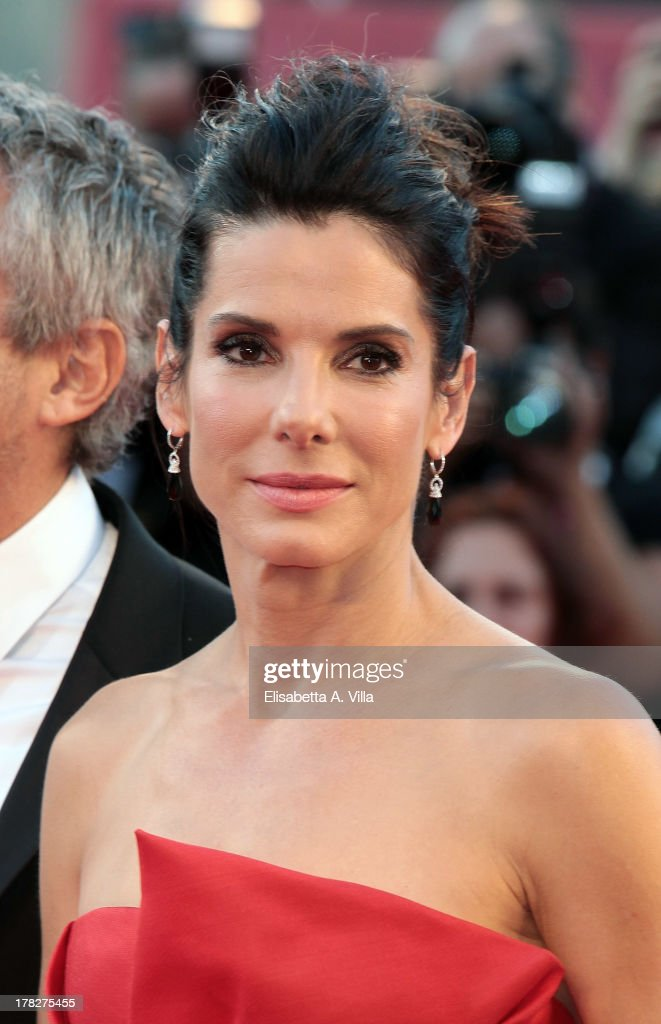 Actress <a gi-track='captionPersonalityLinkClicked' href=/galleries/search?phrase=Sandra+Bullock&family=editorial&specificpeople=202248 ng-click='$event.stopPropagation()'>Sandra Bullock</a> attends 'Gravity' Premiere and Opening Ceremony during the 70th Venice International Film Festival at the Palazzo del Cinema on August 28, 2013 in Venice, Italy.
