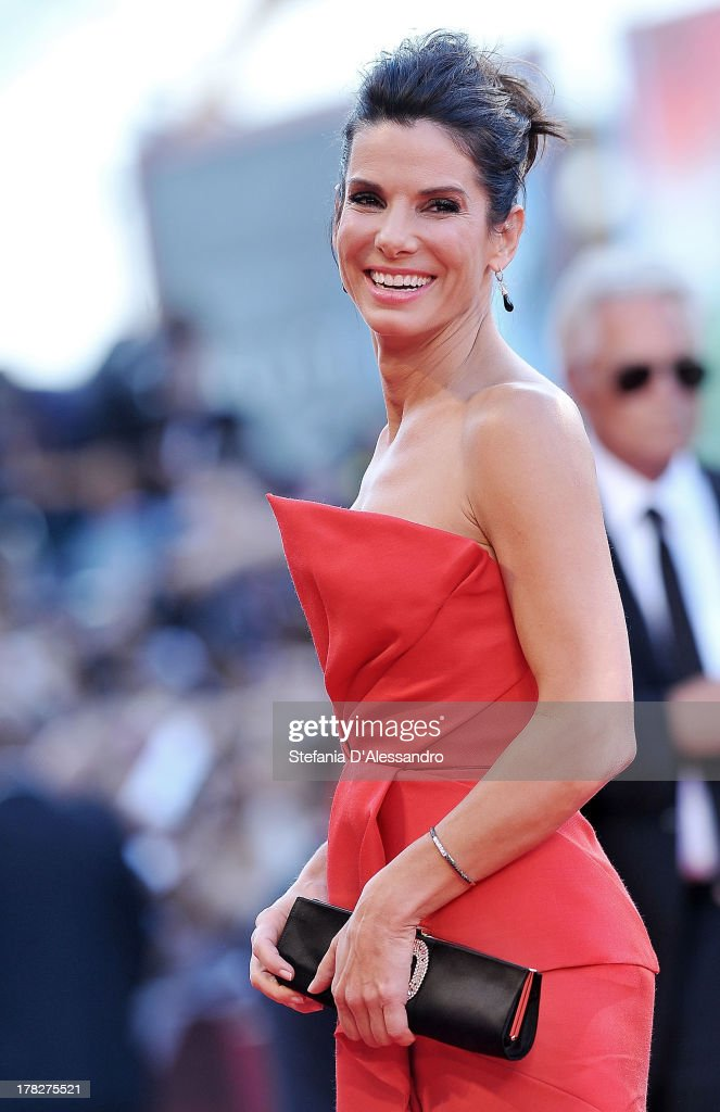 Actress <a gi-track='captionPersonalityLinkClicked' href=/galleries/search?phrase=Sandra+Bullock&family=editorial&specificpeople=202248 ng-click='$event.stopPropagation()'>Sandra Bullock</a> attends 'Gravity' premiere and Opening Ceremony during The 70th Venice International Film Festival at Sala Grande on August 28, 2013 in Venice, Italy.