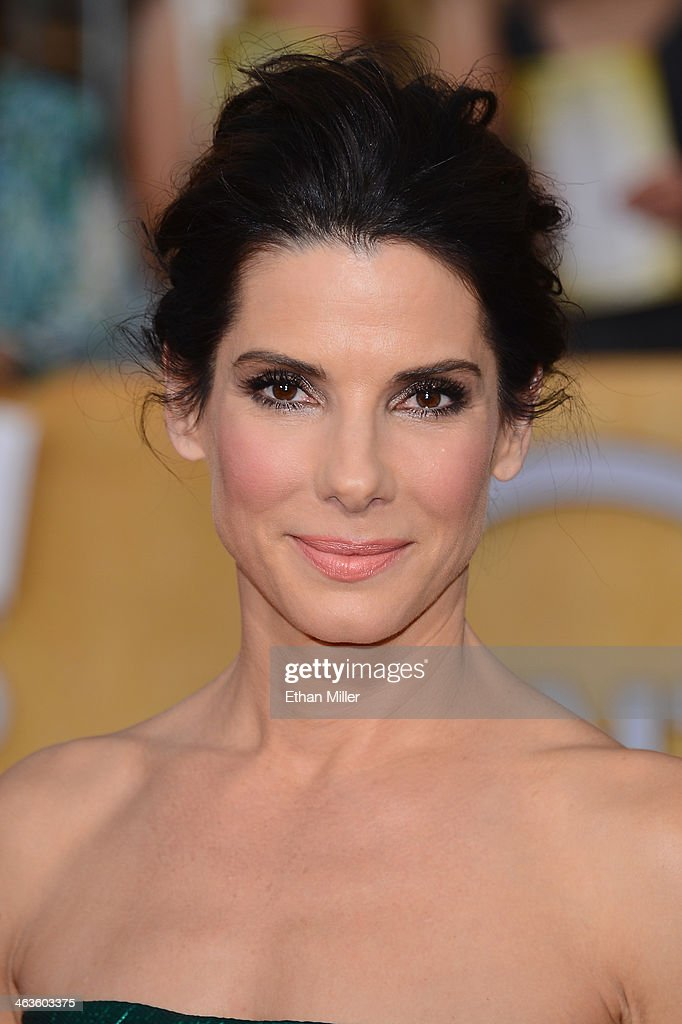 Actress <a gi-track='captionPersonalityLinkClicked' href=/galleries/search?phrase=Sandra+Bullock&family=editorial&specificpeople=202248 ng-click='$event.stopPropagation()'>Sandra Bullock</a> attends the 20th Annual Screen Actors Guild Awards at The Shrine Auditorium on January 18, 2014 in Los Angeles, California.