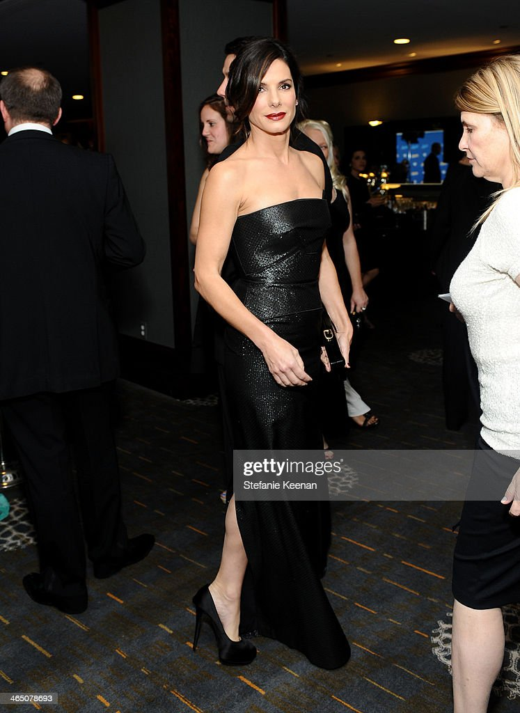 Actress <a gi-track='captionPersonalityLinkClicked' href=/galleries/search?phrase=Sandra+Bullock&family=editorial&specificpeople=202248 ng-click='$event.stopPropagation()'>Sandra Bullock</a> attends the 66th Annual Directors Guild Of America Awards held at the Hyatt Regency Century Plaza on January 25, 2014 in Century City, California.