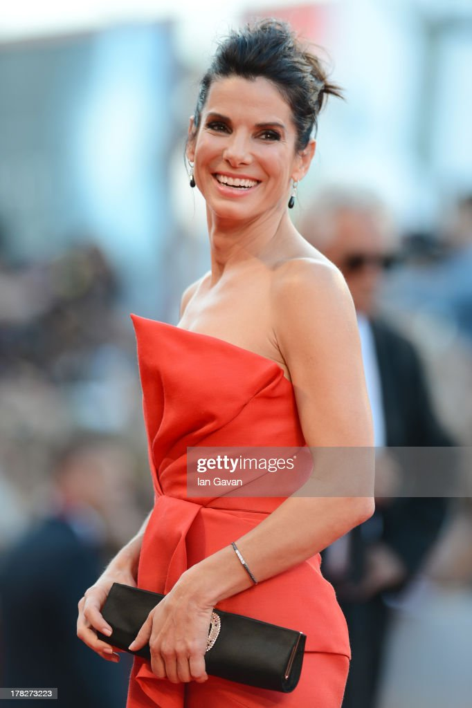 Actress <a gi-track='captionPersonalityLinkClicked' href=/galleries/search?phrase=Sandra+Bullock&family=editorial&specificpeople=202248 ng-click='$event.stopPropagation()'>Sandra Bullock</a> attends the Opening Ceremony And 'Gravity' Premiere during the 70th Venice International Film Festival at the Palazzo del Cinema on August 28, 2013 in Venice, Italy.