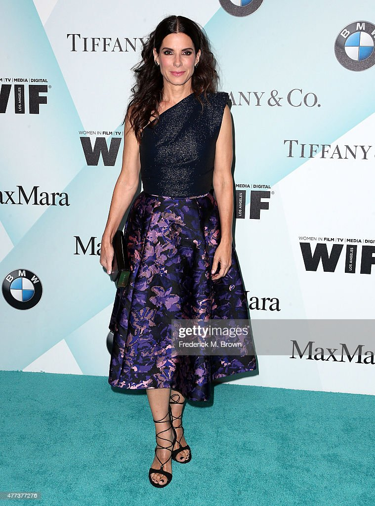 Actress <a gi-track='captionPersonalityLinkClicked' href=/galleries/search?phrase=Sandra+Bullock&family=editorial&specificpeople=202248 ng-click='$event.stopPropagation()'>Sandra Bullock</a> attends the Women in Film 2015 Crystal + Lucy Awards at the Hyatt Regency Century Plaza Hotel on June 16, 2015 in Los Angeles, California.