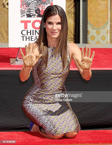Actress Sandra Bullock poses at her Hand and Footprint Ceremony at TCL Chinese Theatre on September 25 2013 in Hollywood California