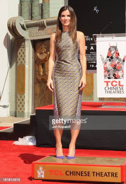Actress Sandra Bullock poses at Sandra Bullock Hand and Footprint Ceremony at TCL Chinese Theatre on September 25 2013 in Hollywood California