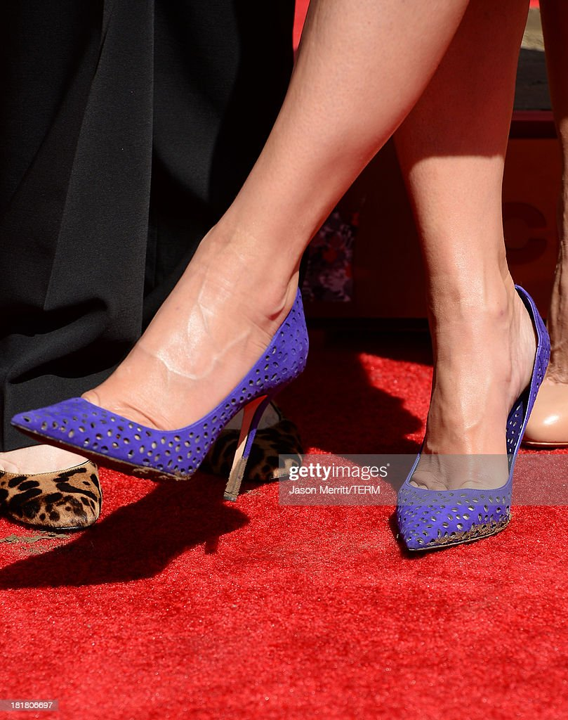 Actress Sandra Bullock poses for a photo as she is immortalized with a hand and footprint ceremony at TCL Chinese Theatre on September 25, 2013 in Hollywood, California.