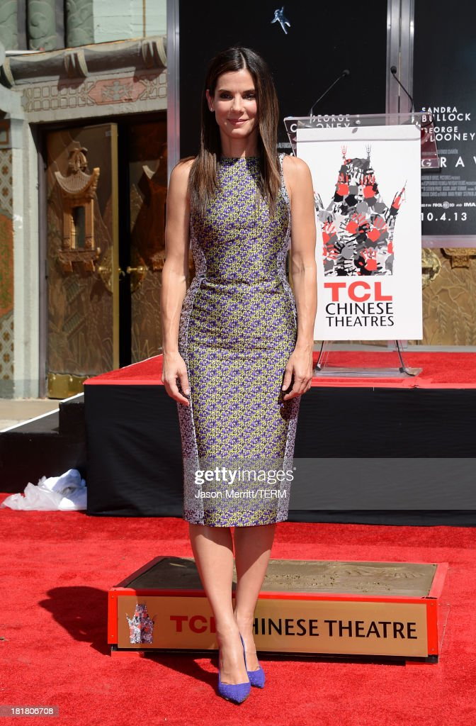 Actress <a gi-track='captionPersonalityLinkClicked' href=/galleries/search?phrase=Sandra+Bullock&family=editorial&specificpeople=202248 ng-click='$event.stopPropagation()'>Sandra Bullock</a> poses for a photo as she is immortalized with a hand and footprint ceremony at TCL Chinese Theatre on September 25, 2013 in Hollywood, California.