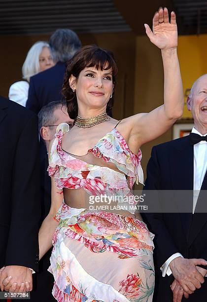 US actress Sandra Bullock waves to spectators on the steps of the palais des festivals before attending the gala screening of the film 'Murder by...