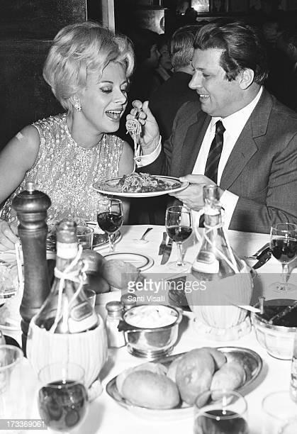 Actress Sandra Milo with singer Gianni Raimondi eating pasta on April 201966 in New York New York