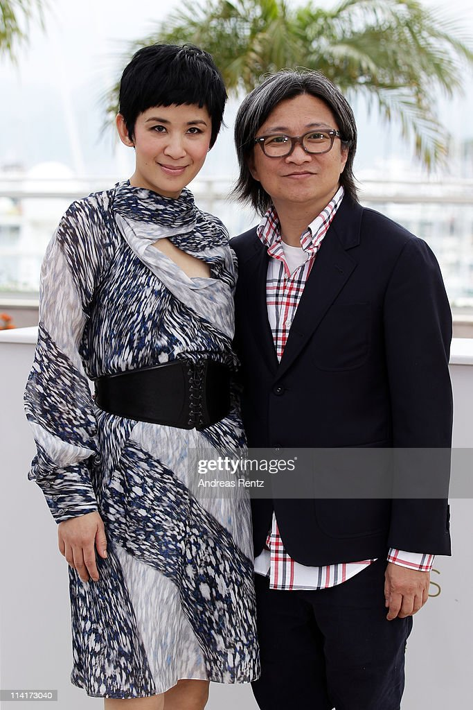 Actress Sandra Ng Kwan Yu and director Peter Chan attend the 'Wu Xia' Photocall at the Palais des Festivals during the 64th Cannes Film Festival on...
