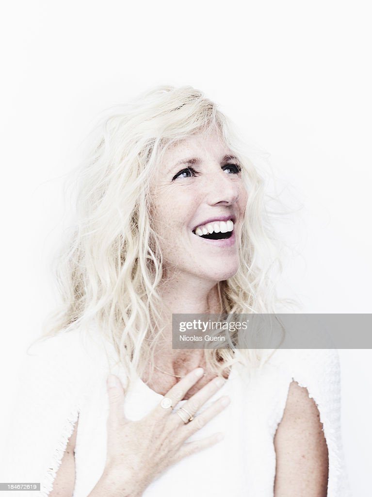 Actress <a gi-track='captionPersonalityLinkClicked' href=/galleries/search?phrase=Sandrine+Kiberlain&family=editorial&specificpeople=832890 ng-click='$event.stopPropagation()'>Sandrine Kiberlain</a> is photographed for Self Assignment on September 9, 2013 in Paris, France.