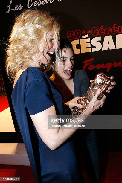 Actress Sandrine Kiberlain winner of the Best Actress award celebrates her award with daughter Suzanne as they attends= dinner after the 39th Cesar...