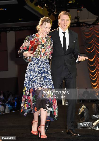 Actress Saoirse Ronan accepts the International Star Award from actor Paul Dano onstage at the 27th Annual Palm Springs International Film Festival...