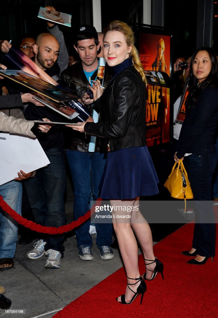 Actress Saoirse Ronan arrives at the Los Angeles premiere of 'How I Live Now' at ArcLight Hollywood on November 5 2013 in Hollywood California
