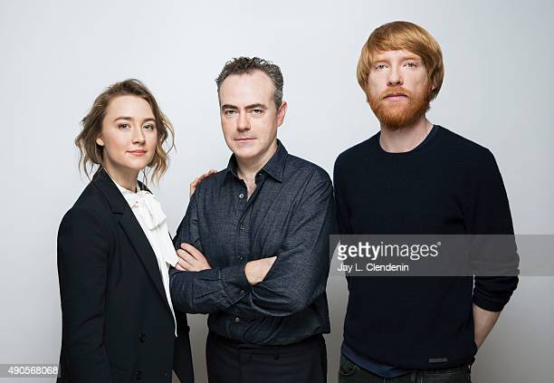 Actress Saoirse Ronan director John Crowley and Domhnall Gleeson of the film Brooklyn' are photographed for Los Angeles Times on September 25 2015 in...