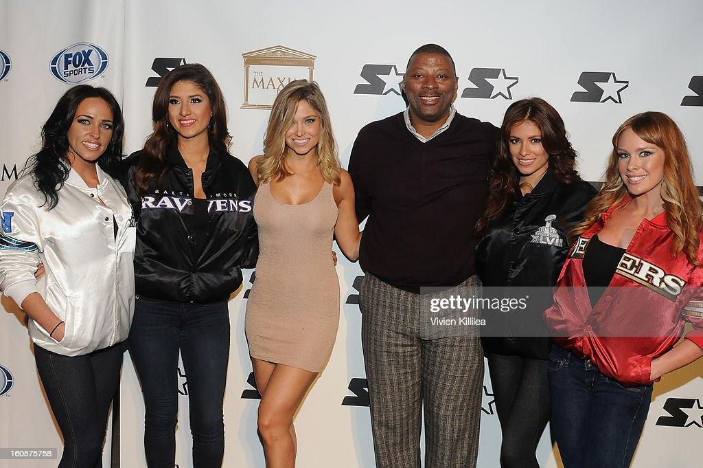 Actress Sara Ash Davis and NFL player <a gi-track='captionPersonalityLinkClicked' href=/galleries/search?phrase=Carl+Banks&family=editorial&specificpeople=591658 ng-click='$event.stopPropagation()'>Carl Banks</a> pose on the Starter Red Carpet at the Maxim Party during Super Bowl XLVII at Second Line Warehouse on February 2, 2013 in New Orleans, Louisiana.
