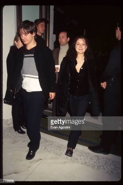 Actress Sara Gilbert and actor Tobey Maguire attend the grand opening of a new Versace Boutique on 5th Avenue October 26 1996 in New York City Gianni...