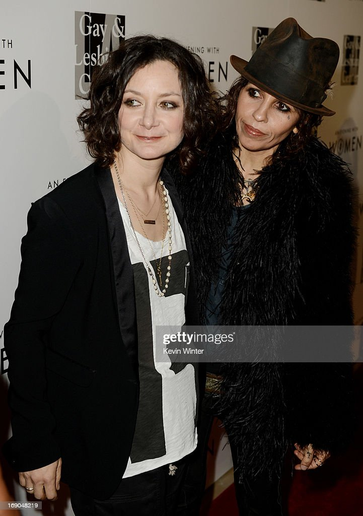 Actress Sara Gilbert (L) and her partner producer/musician Linda Perry arrive at An Evening With Women benefiting The L.A. Gay & Lesbian Center at the Beverly Hilton Hotel on May 18, 2013 in Beverly Hills, California.