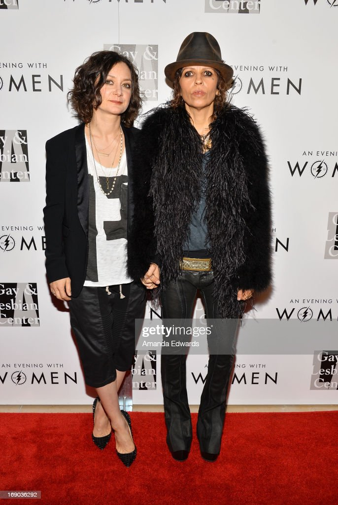 Actress Sara Gilbert (L) and music producer Linda Perry arrive at the L.A. Gay & Lesbian Center's 2013 'An Evening With Women' Gala at The Beverly Hilton Hotel on May 18, 2013 in Beverly Hills, California.