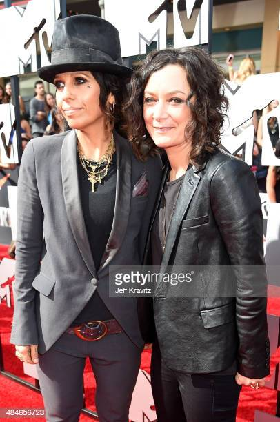 Actress Sara Gilbert and musician Linda Perry attend the 2014 MTV Movie Awards at Nokia Theatre LA Live on April 13 2014 in Los Angeles California