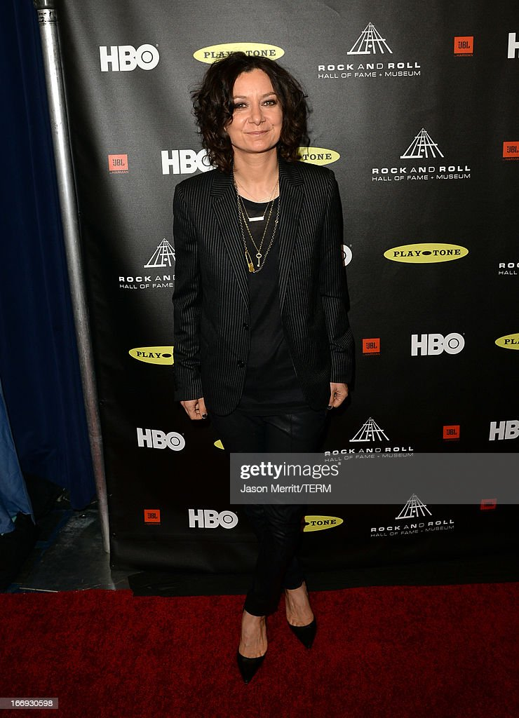 Actress <a gi-track='captionPersonalityLinkClicked' href=/galleries/search?phrase=Sara+Gilbert&family=editorial&specificpeople=585732 ng-click='$event.stopPropagation()'>Sara Gilbert</a> arrives at the 28th Annual Rock and Roll Hall of Fame Induction Ceremony at Nokia Theatre L.A. Live on April 18, 2013 in Los Angeles, California.