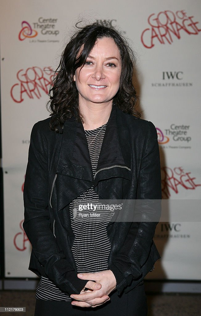Actress <a gi-track='captionPersonalityLinkClicked' href=/galleries/search?phrase=Sara+Gilbert&family=editorial&specificpeople=585732 ng-click='$event.stopPropagation()'>Sara Gilbert</a> poses during the arrivals for the opening night performance of 'God of Carnage' at Center Theatre Group's Ahmanson Theatre on April 13, 2011 in Los Angeles, California.