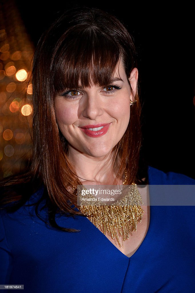 Actress <a gi-track='captionPersonalityLinkClicked' href=/galleries/search?phrase=Sara+Rue&family=editorial&specificpeople=203287 ng-click='$event.stopPropagation()'>Sara Rue</a> arrives at the Escada and W Magazine shopping event benefiting the Cool Earth Organization at Escada Boutique on September 26, 2013 in Beverly Hills, California.