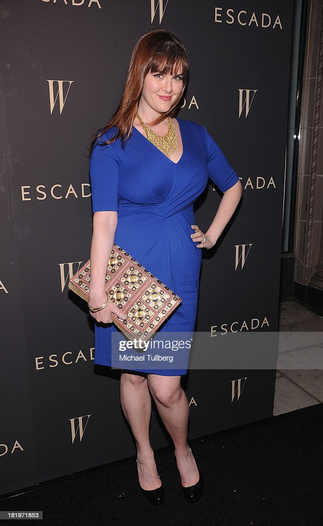 Actress <a gi-track='captionPersonalityLinkClicked' href=/galleries/search?phrase=Sara+Rue&family=editorial&specificpeople=203287 ng-click='$event.stopPropagation()'>Sara Rue</a> attends the 'Celebrate Cool Earth' benefit for the Cool Earth Foundation at Escada Boutique on September 26, 2013 in Beverly Hills, California.
