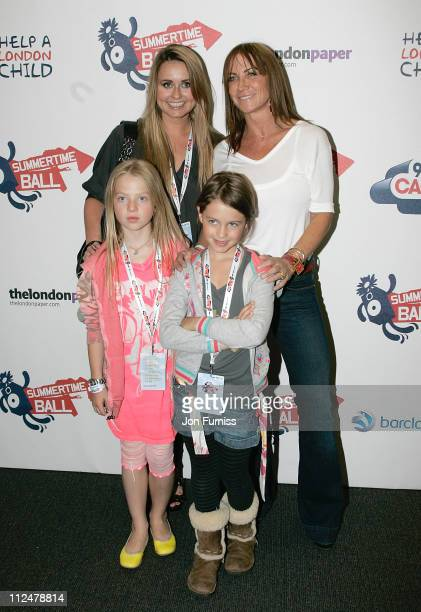 Actress Sarah Barrand Meg Matthews and guests attends the Capital FM Summertime Ball at the Emirates Stadium on June 7 2009 in London England