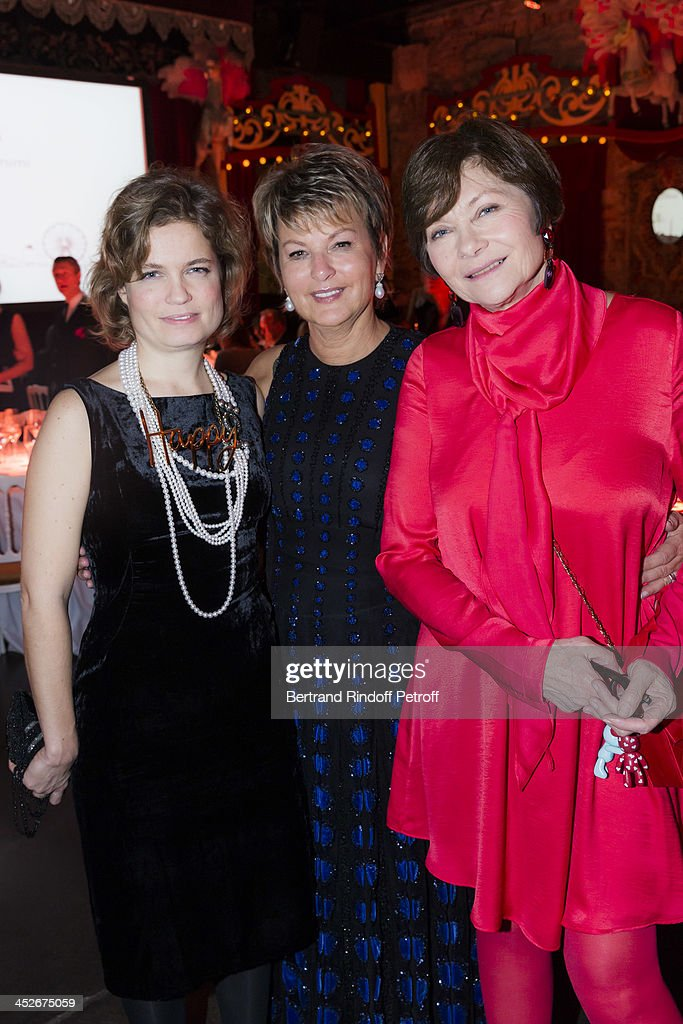Actress Sarah Biasini, Baroness Myriam Ullens de Schooten, President of the Mimi Foundation, and actress <a gi-track='captionPersonalityLinkClicked' href=/galleries/search?phrase=Macha+Meril&family=editorial&specificpeople=672802 ng-click='$event.stopPropagation()'>Macha Meril</a> (Princess Gagarina) attend the Mimi Foundation gala dinner at Musee des Arts Forains on November 30, 2013 in Paris, France.