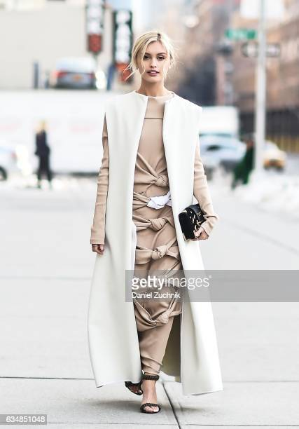 Actress Sarah Ellen is seen wearing a white sleeveless coat and beige knotted dress at the Dion Lee show during New York Fashion Week Women's...