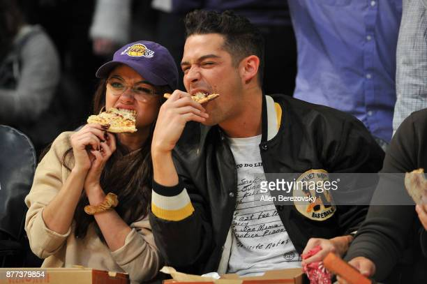 Actress Sarah Hyland and boyfriend Wells Adams attend a basketball game between the Los Angeles Lakers and the Chicago Bulls at Staples Center on...