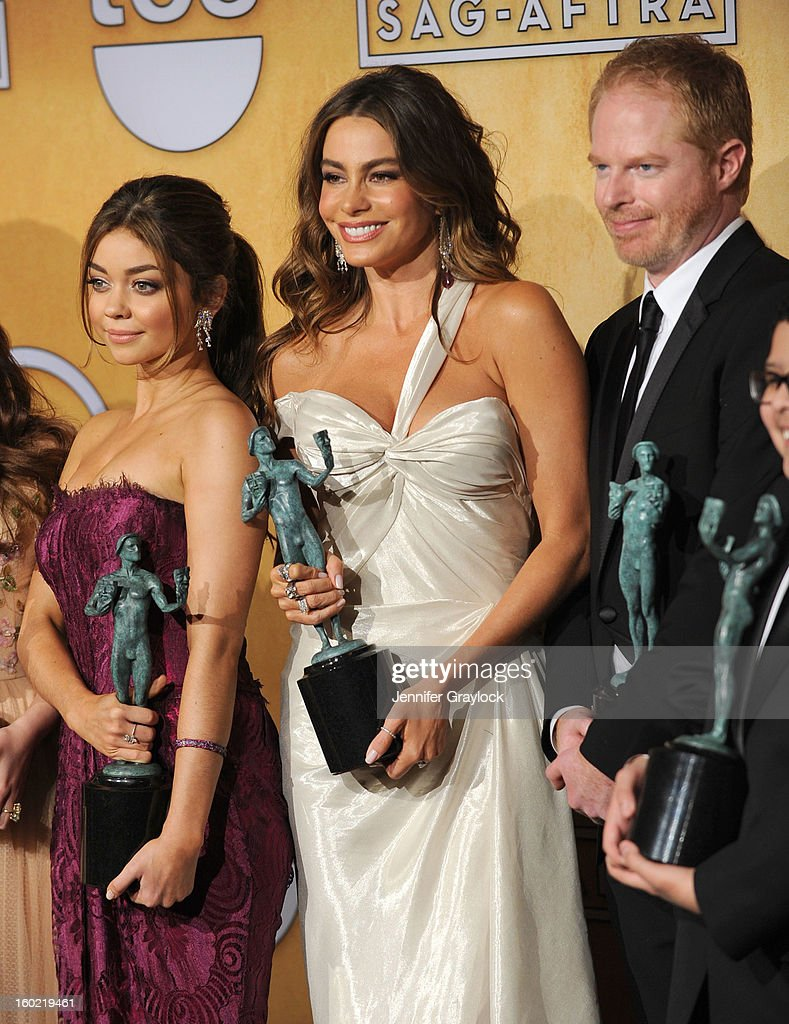 Actress Sarah Hyland, Sofia Vergara and Jesse Tyler Ferguson winners of Outstanding Performance by an Ensemble in a Comedy Series for 'Modern Family,' poses in the press room during the 19th Annual Screen Actors Guild Awards held at The Shrine Auditorium on January 27, 2013 in Los Angeles, California.