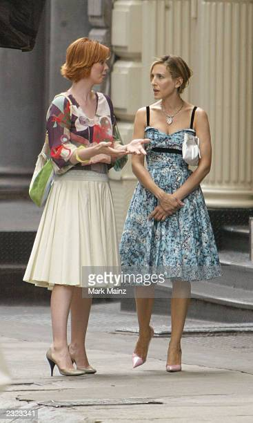 Actress Sarah Jessica Parker and actress Cynthia Nixon walk on the set of the hit HBO series 'Sex and the City' July 29 2003 in SoHo New York City