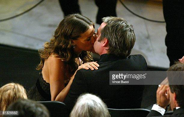 Actress Sarah Jessica Parker kisses her husband actor Matthew Broderick after winning an award for Best Actress in a Comedy Series for 'Sex and the...