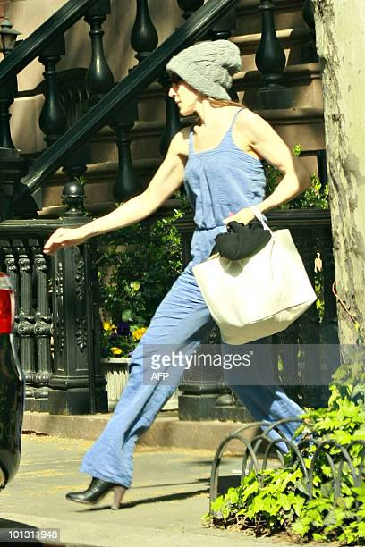 Actress Sarah Jessica Parker leaves her house dressed as a mildmannered every day woman carrying her superhero dress to a 'Sex and the City' press...