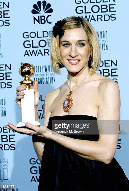 Actress Sarah Jessica Parker poses backstage with her award during the 59th Annual Golden Globe Awards at the Beverly Hilton Hotel January 20 2002 in...