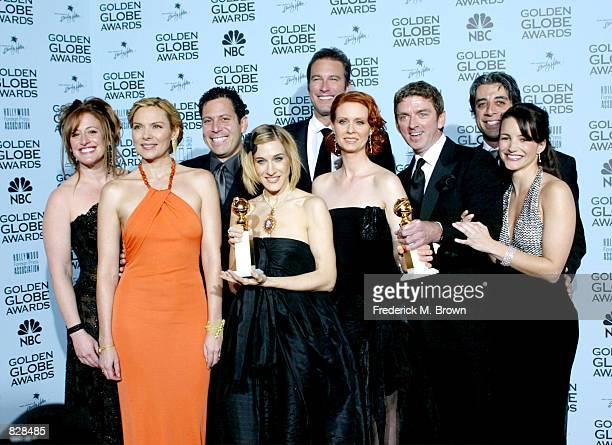 Actress Sarah Jessica Parker poses with her castmates and the creators of 'Sex And The City' backstage during the 59th Annual Golden Globe Awards at...