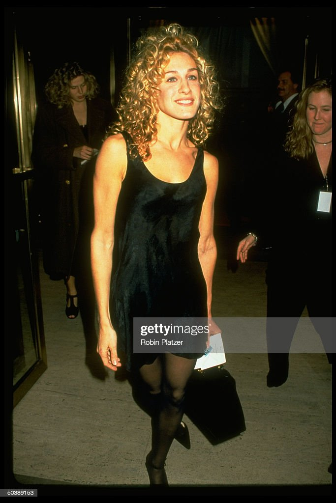 Actress Sarah Jessica Parker wearing simple short black dress by Calvin Klein