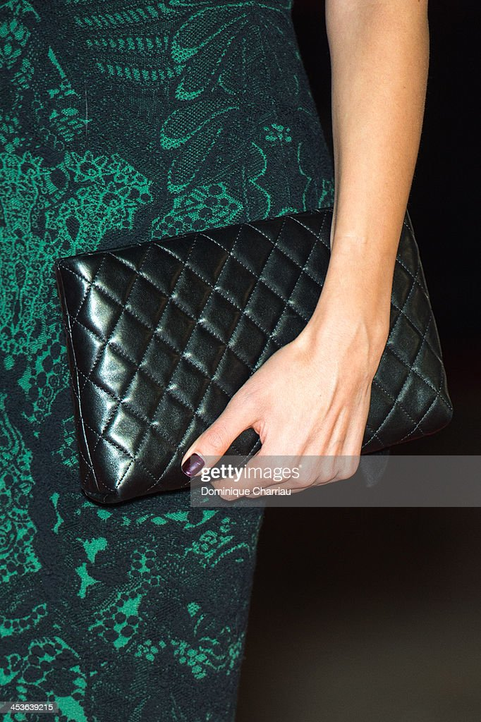 Actress <a gi-track='captionPersonalityLinkClicked' href=/galleries/search?phrase=Sarah+Kazemy&family=editorial&specificpeople=7448699 ng-click='$event.stopPropagation()'>Sarah Kazemy</a> ( clutch detail ) attends the 'Traitors' Photocall during the 13th Marrakech International Film Festival on December 4, 2013 in Marrakech, Morocco.